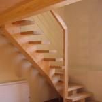 Escalier à limon central courbe