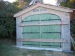 04-09 Porte de garage cintré en 3 plies épicéa 4 vantaux